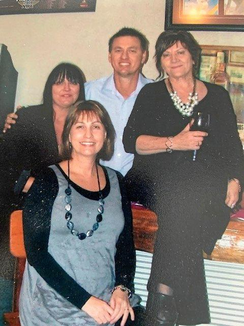 MUCH LOVED: The late Anita Ricketts (right) with children Kimberley (left), Steve and Melanie at Anita's 70th birthday party.