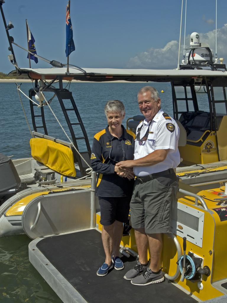 FEMALE FIRST: Commander Roger Pearce AFSM congratulates Kaye Kirwan from Coast Guard Caloundra's Echo crew on becoming the first female to complete the in-house Coxswain Training Course. Photo: Contributed