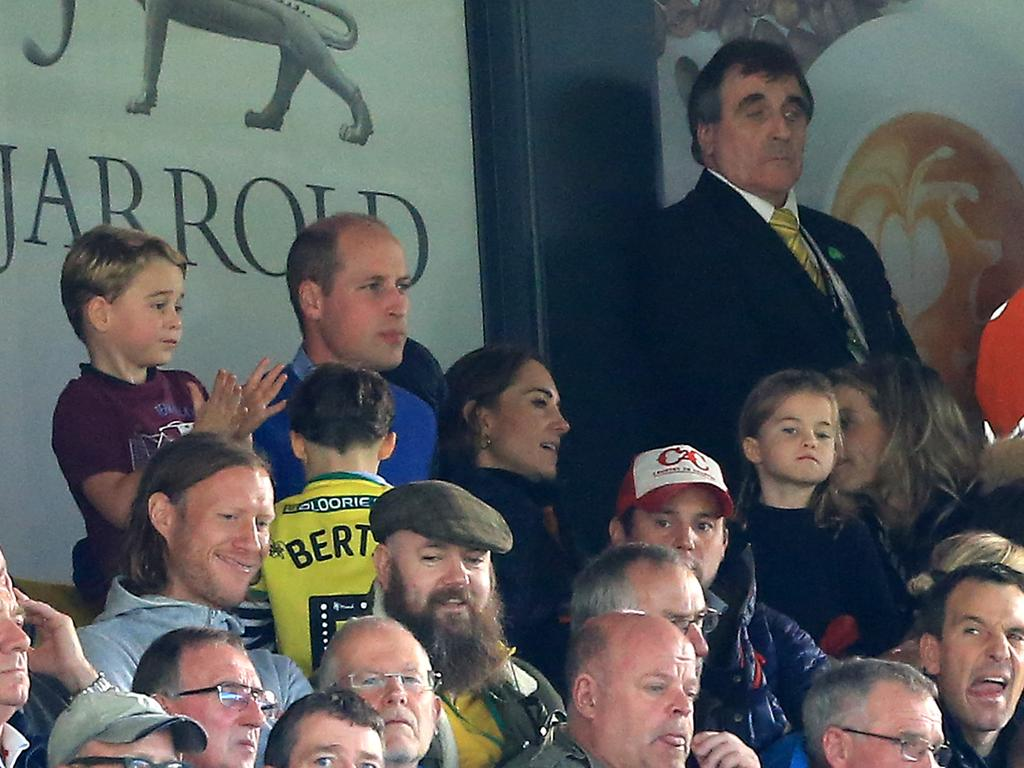 Prince George, Prince William, Kate and Princess Charlotte are seen in the stands during the Premier League match between Norwich City and Aston Villa on October 5. Picture: Stephen Pond/Getty Images