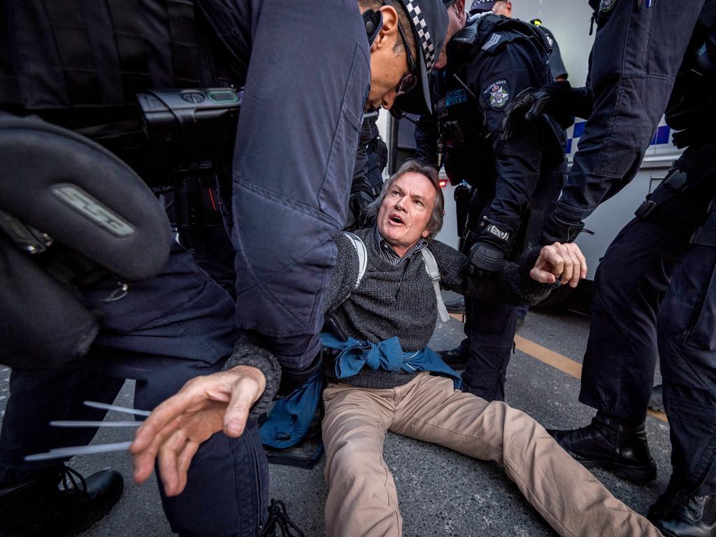 Protesters were arrested after blocking Flinders Street in Melbourne. Picture: Jake Nowakowski