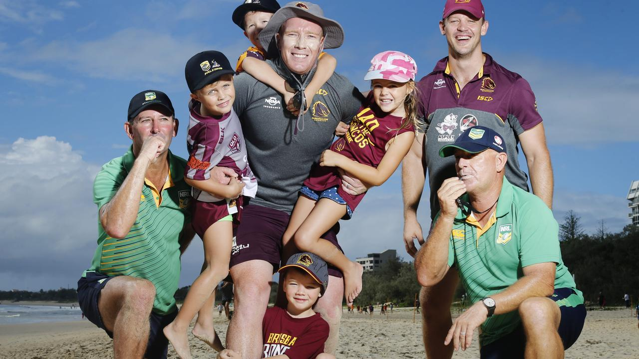 BRONCOS HIT BEACH: Noah Bourke, Billy Hinson, Matilda Tilly and Aero Melbourne hang from Broncos legend Jack Reed at a Broncos School Holidays beach clinic at Mooloolaba. Photo: Lachie Millard