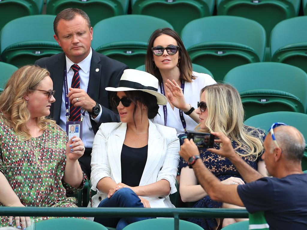 Meghan was left red-faced after her bodyguard asked this man to stop taking photos of her — when he was in fact snapping a selfie with the court in the background. Picture: Mike Egerton/PA Wire