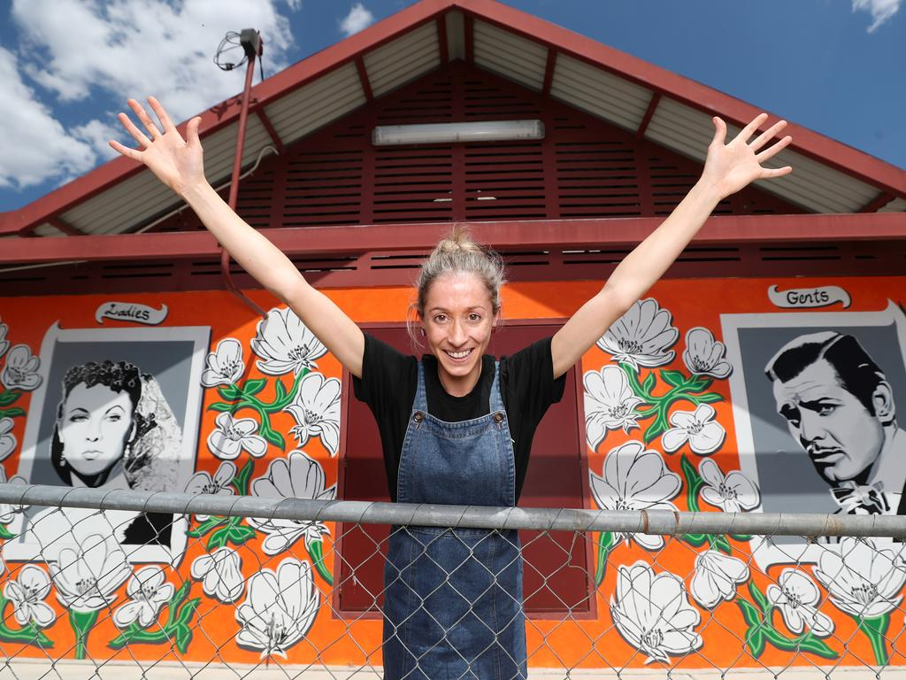 Kristy O'Brien at one of the painted toilets in The Dunny Run tourist attraction around Stanthorpe. Picture: Peter Wallis