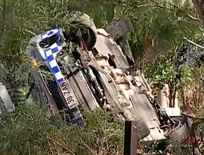The badly damaged police car near Cooroy.