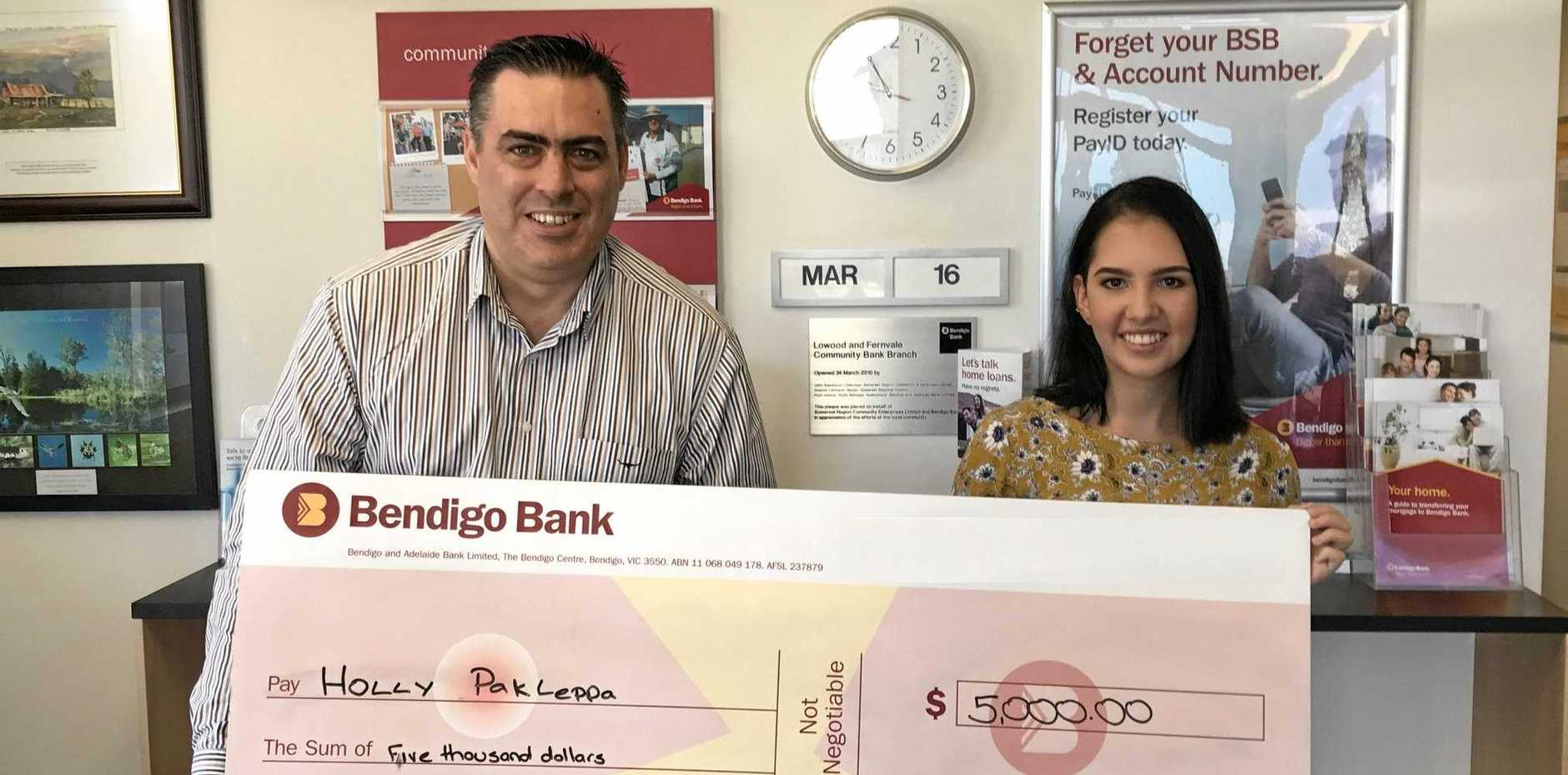 OUR BANK: Holly Pakleppa receives a scholarship cheque from Chairman of Lowood and Fernvale Community Bank Keith Manz - just one of the many ways the bank helps the community.
