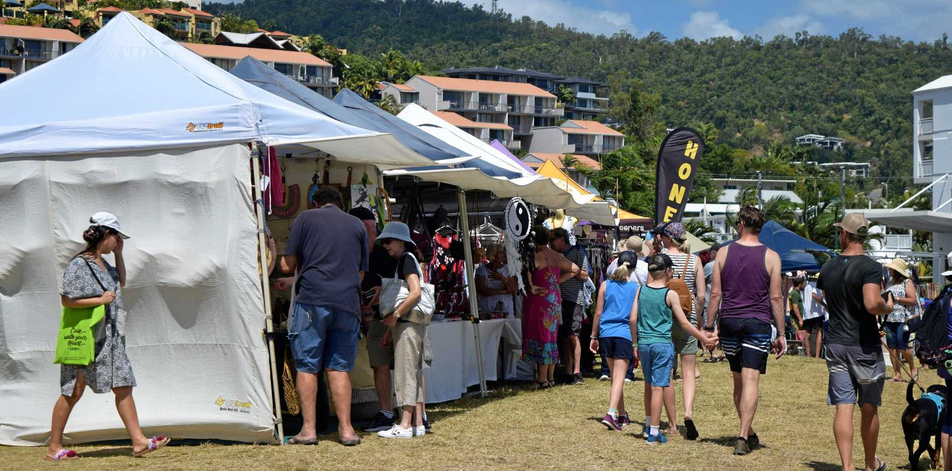 The Lions Airlie Beach Community Markets will have to remain at the Coconut Grove site for longer as top-dressing is needed on the grass at the foreshore before the markets can move back there.