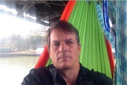 Paul Jukes has suspended himself in hammock underneath the Brisbane Story Bridge.