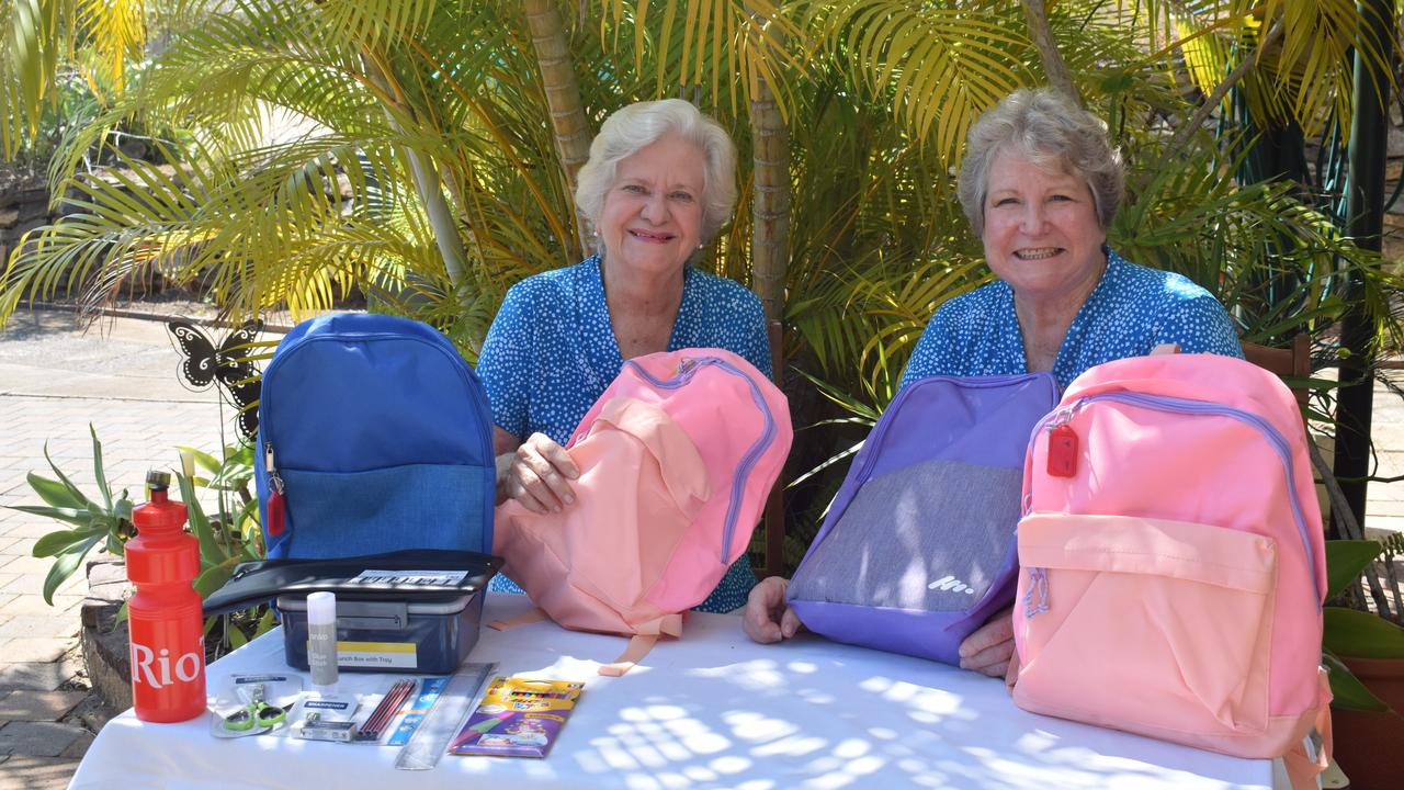 Gladstone Quota Club treasurer Phyllis Lawson and publicity officer Liz Robertson with backpacks filled with school supplies for disadvantaged school kids. The proceeds from its Fun Fashion parade go towards the backpacks.