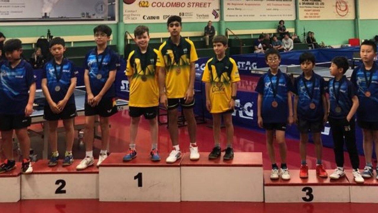 MEDAL HAUL: Oscar Savige (at right) on stage with the Australian team for the presentation of the team's gold medal at the New Zealand table tennis championships.