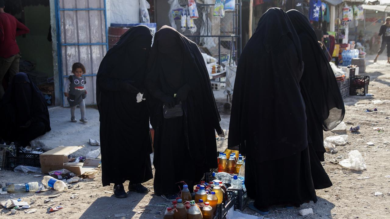 Women buying food in the Al Hawl camp in Syria. The majority of women still wear full Islamic dress, to avoid violence or death by still radicalised women. Picture: Tessa Fox/AAP