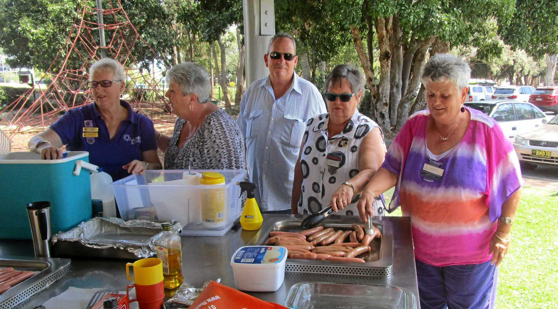 Many hands make light work as the Hervey Bay VIEW Club prepare their sausage sizzle lunch... Robyn Busk, Cathy and Jim Hall, President Heather Ramm, Celie Peach.