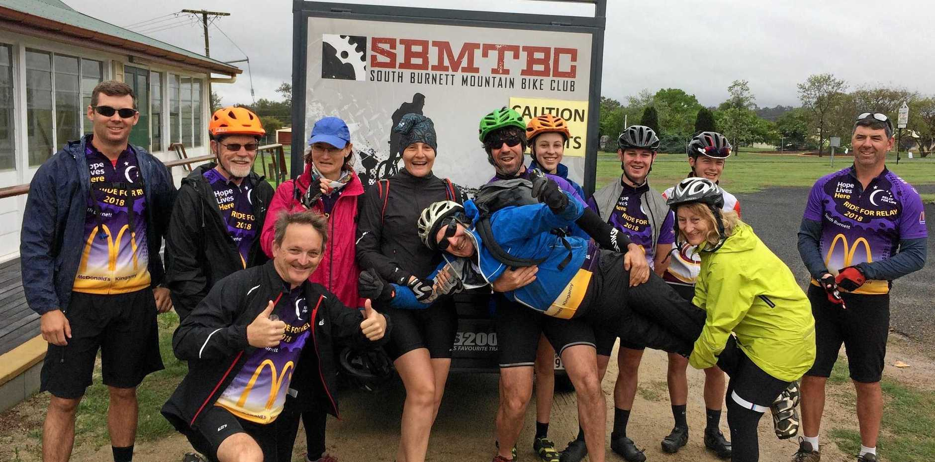 SMILES AND STORMS: The Ride 4 Relay team braves the wild weather during last year's event.