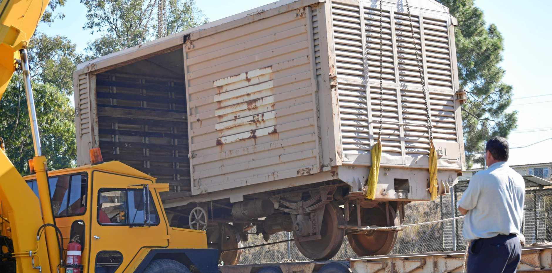 PRESERVING HISTORY: David Zipf is helping unload the railway cargo at the Mundubbera railway precinct.
