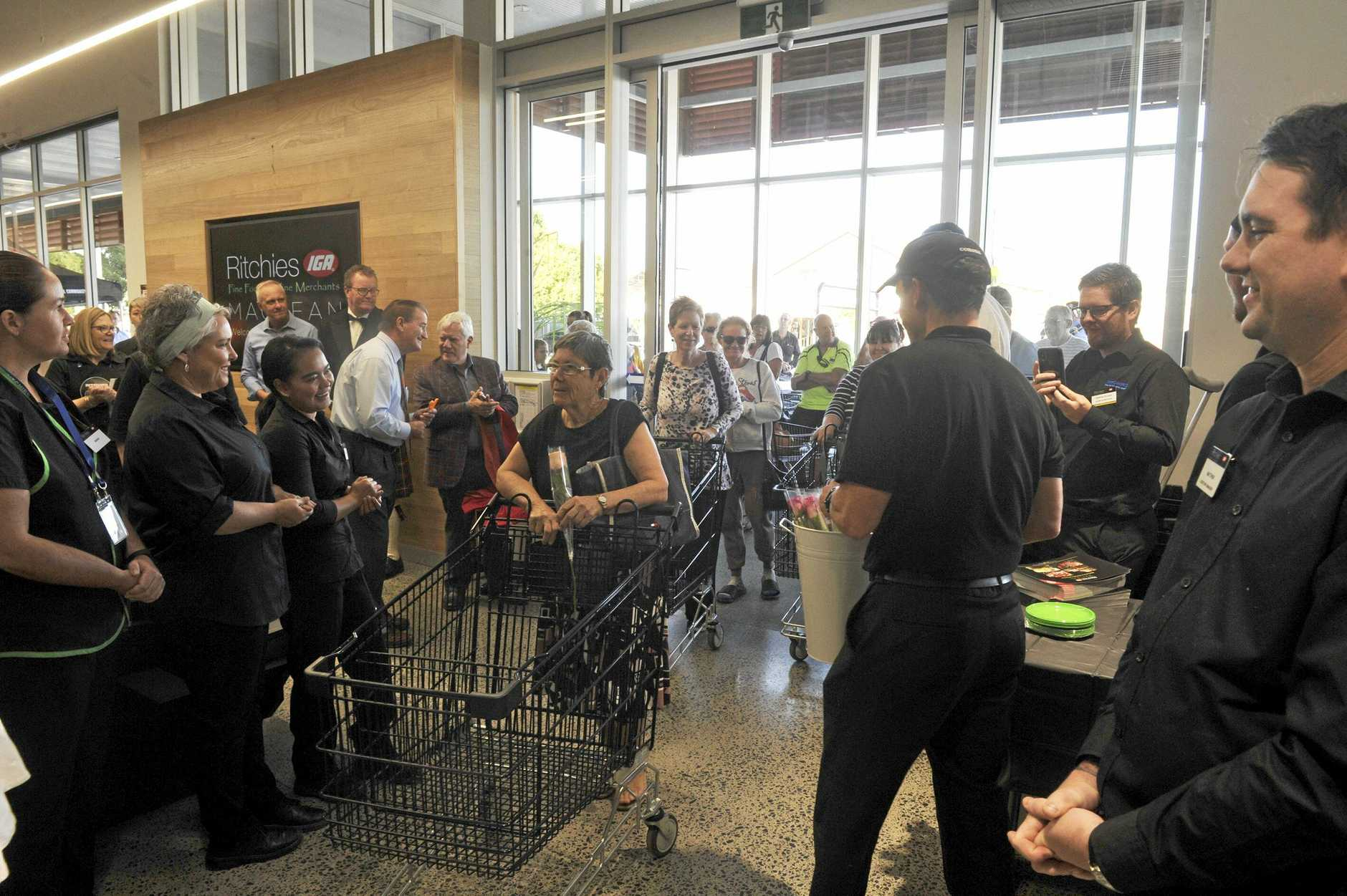 With trolleys in hand, shoppers make their way inside the brave new world of Ritchies IGA supermarket in Maclean.