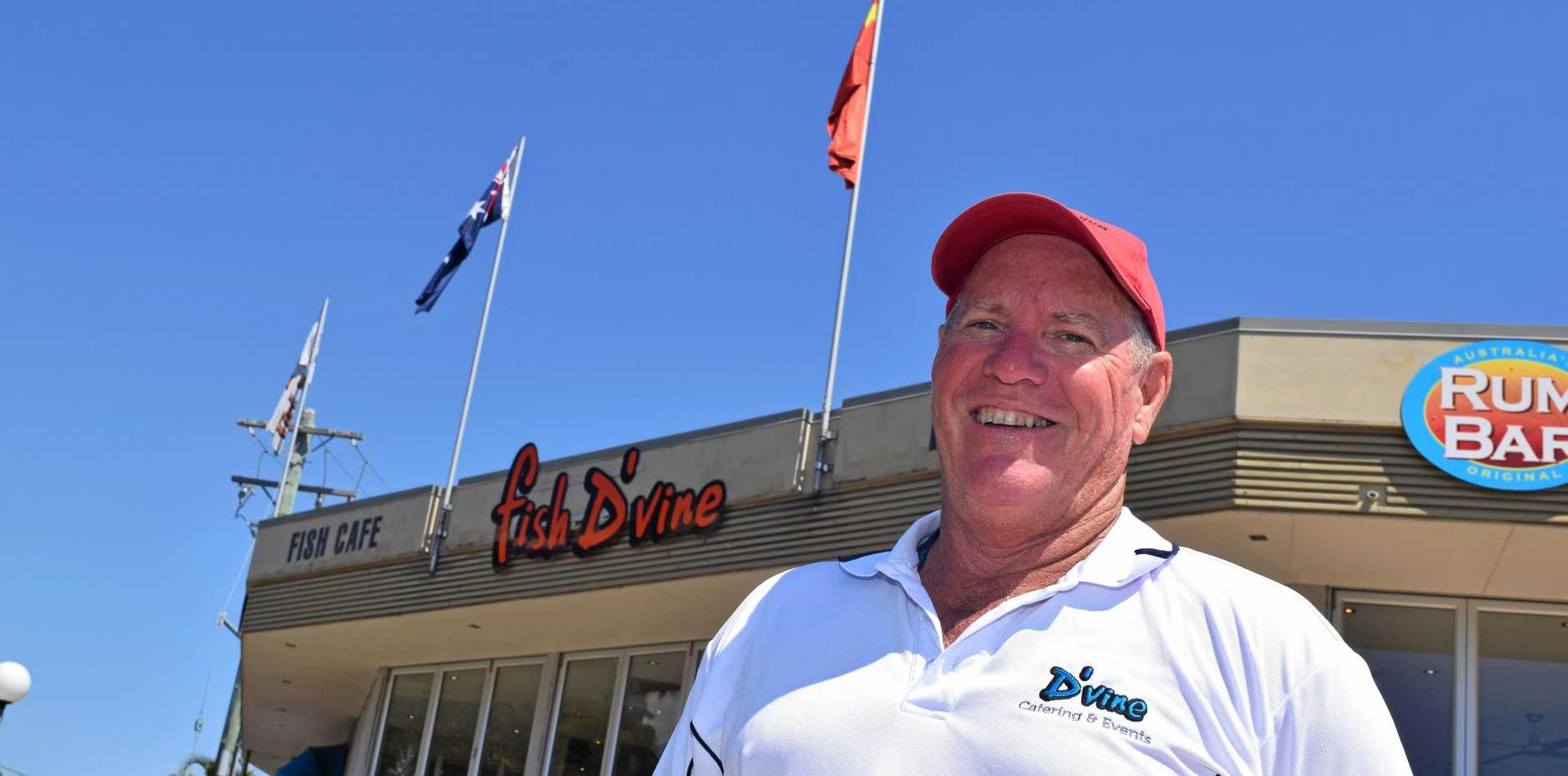 IMPORTANT WEEK: Fish D'Vine and the Rum Bar co-owner Kev Collins with the Chinese flag the restaurant has been flying to welcome tourists to the region during Golden Week.