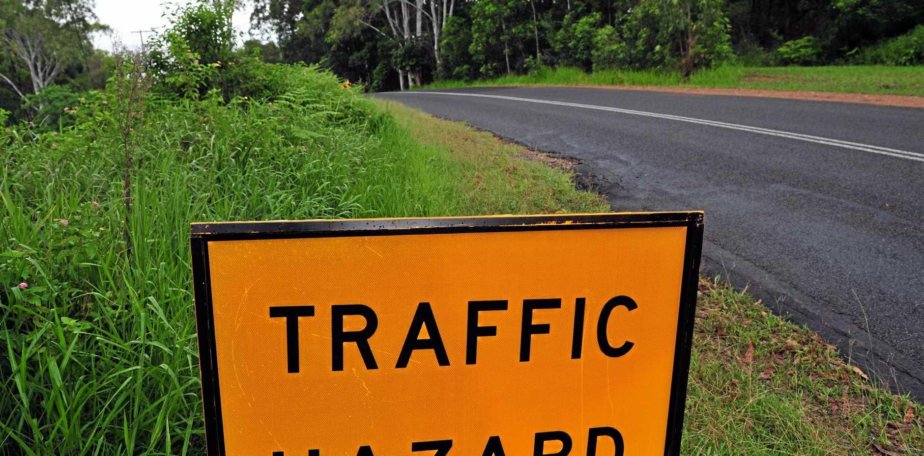 Land slip in Duke Road Doonan poses a hazard to motorists. Traffic Hazard sign Photo Geoff Potter / Noosa News.