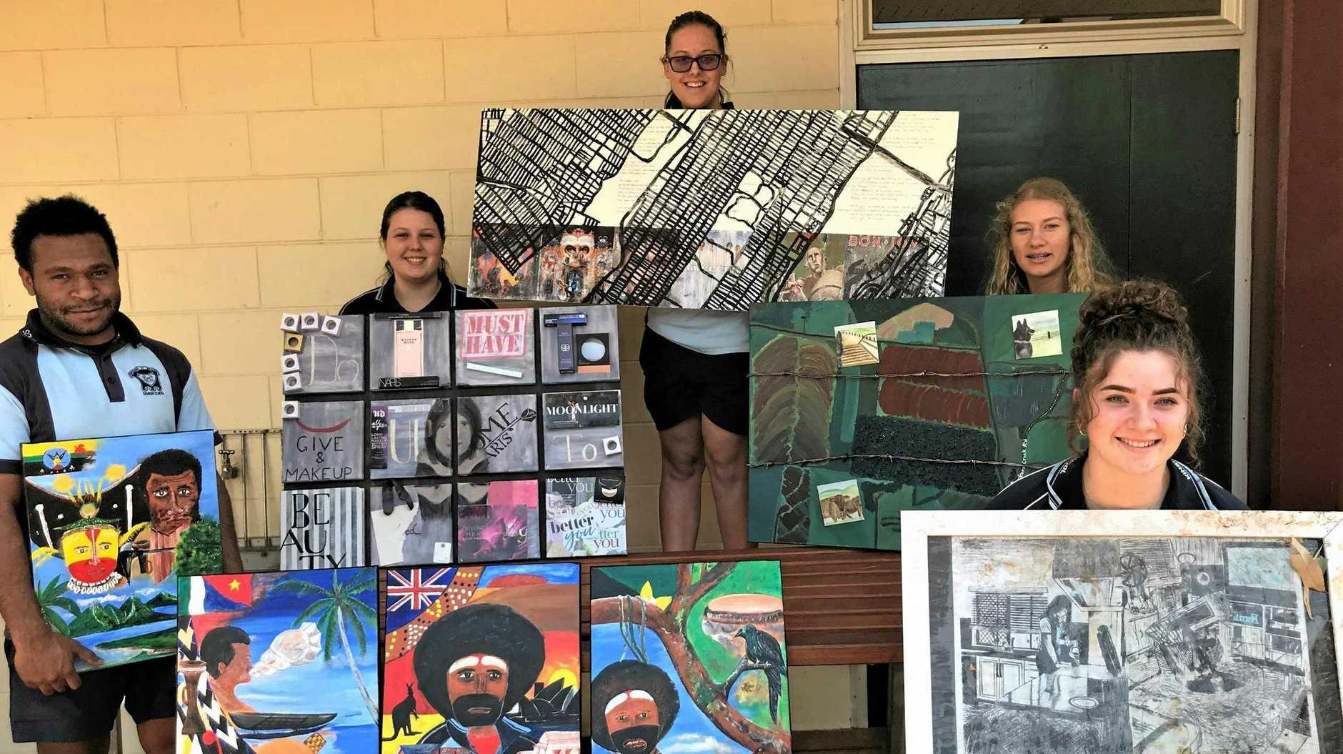 Kingaroy Year 12 students Chendrick Andambo, Megan Frohloff, Ashleigh Lindsay, Tamika Schultz, and Tayla Hayes with their artwork.