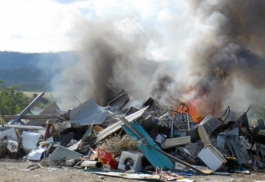 Rubbish catches fire at a Gympie dump in 2015, one of the major concerns which prompted the council's controversial overhaul of their waste services.