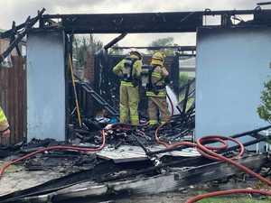 'Whole garage on fire': Fireys rush to house blaze