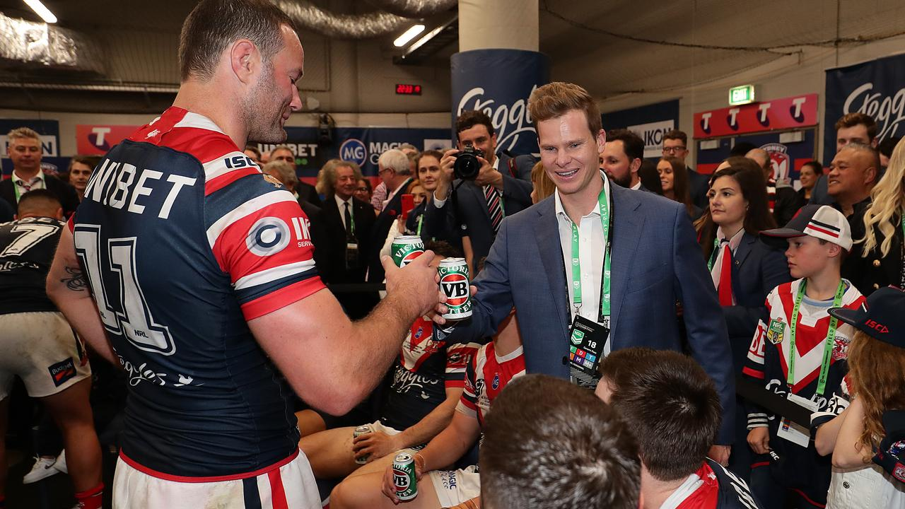 Steve Smith meets with the Roosters players after the NRL grand final.