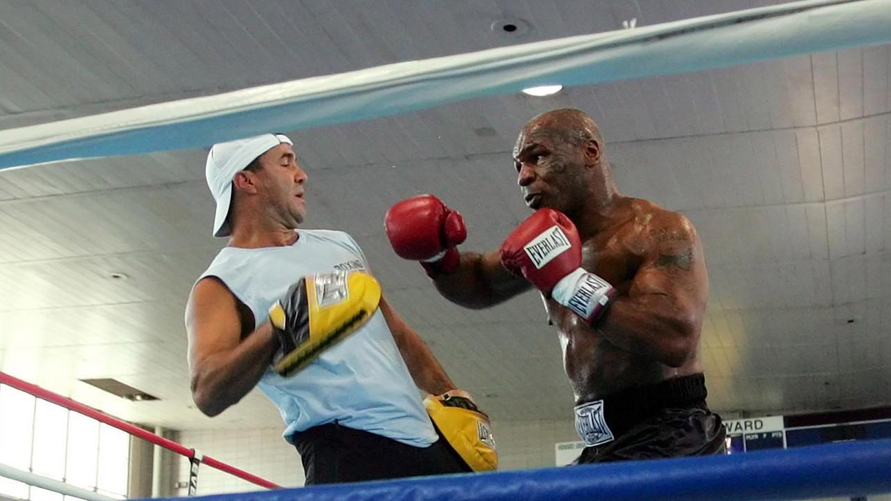 Fenech training Tyson in 2005. Picture: AP Photo/Pablo Martinez Monsivais