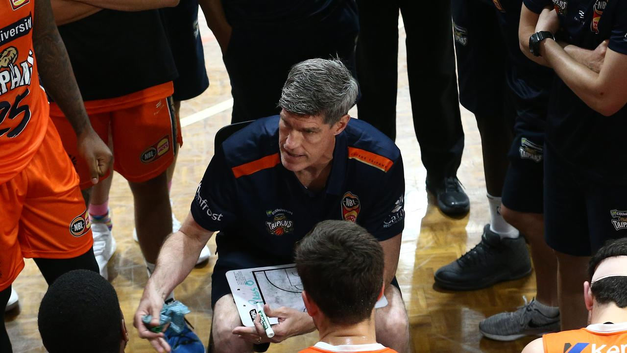 Taipans head coach Mike Kelly inspires his players during a time out in the National Basketball League (NBL) pre season match between the Cairns Taipans and the Brisbane Bullets, held at Early Settler Stadium, Manunda. PICTURE: BRENDAN RADKE.