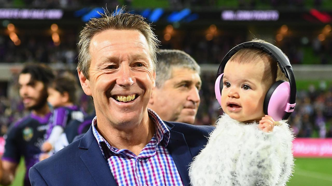 Craig Bellamy with Will Chambers' daughter Kiera. Picture: Quinn Rooney/Getty Images