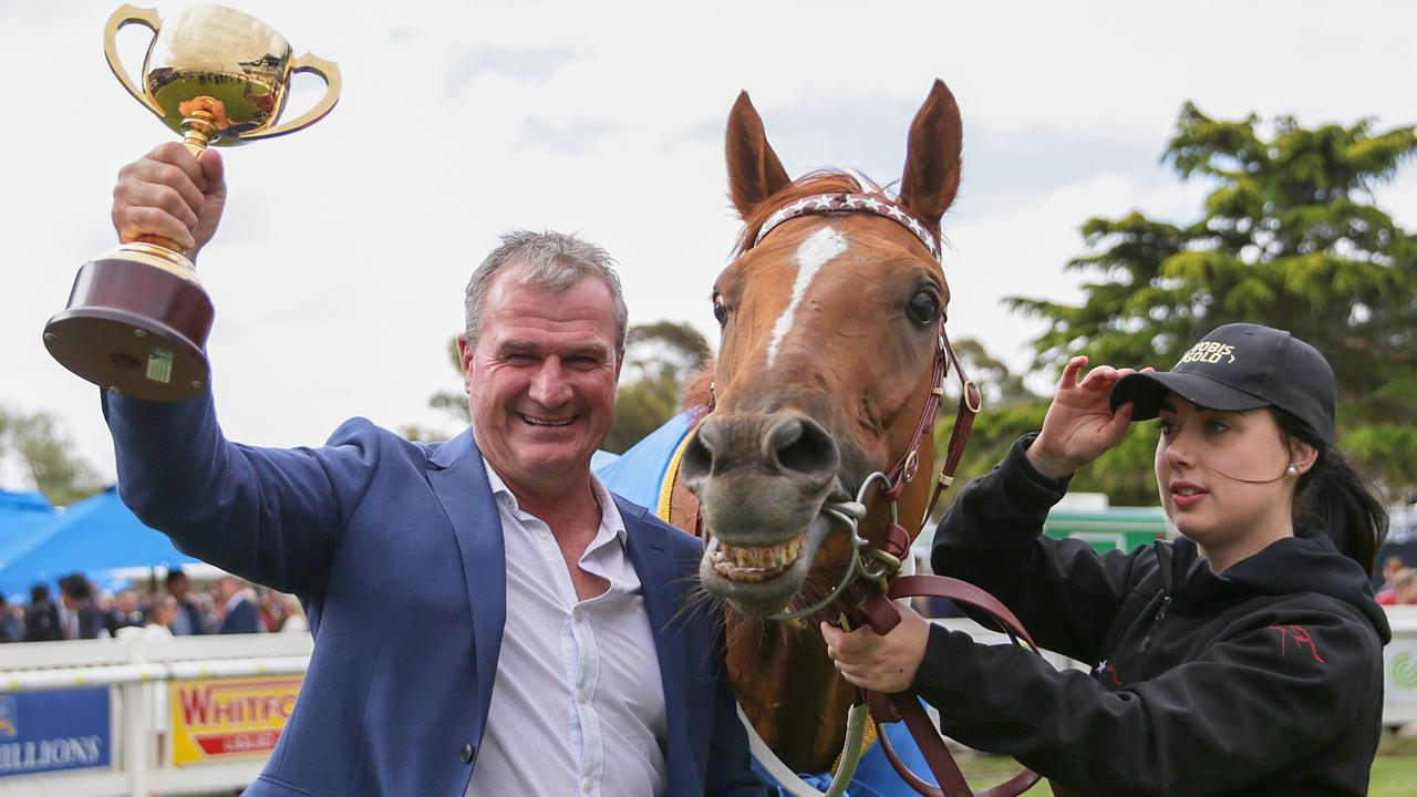 Trainer Darren Weir holds up the Cup after Jockey John Allen rode Kiwia to win the Ballarat Cup.