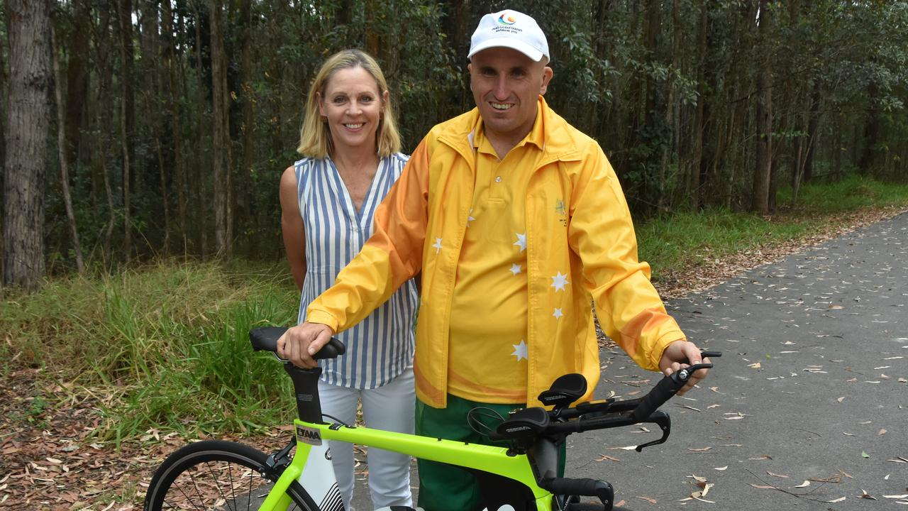 CYCLING: Nathan Glarvey will represent Australia in cycling at the INAS Global Games in Brisbane, pictured with coach Deborah Latouf.
