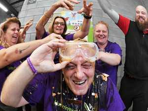 Coast supermarket manager gets 'egged' for charity