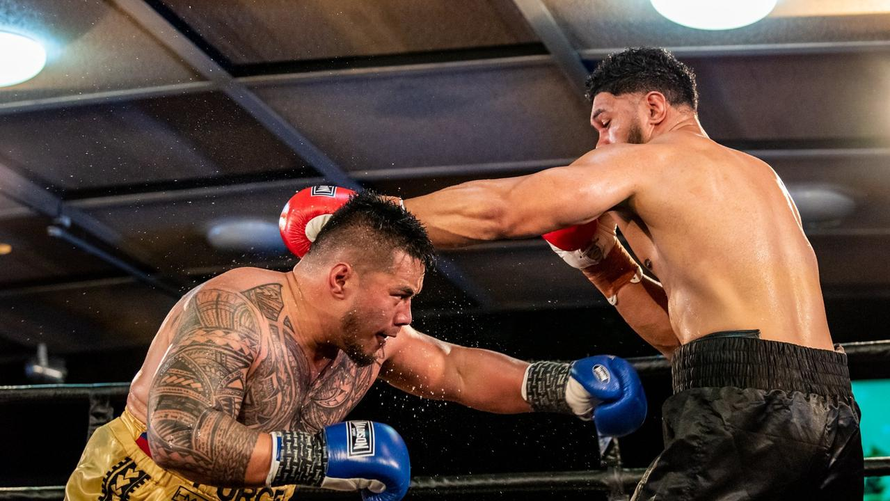 Toowoomba's Herman Ene-Purcell ducks under a Will Nasio's shot as they battle for the Australasian heavyweight title at Rumours International in July.