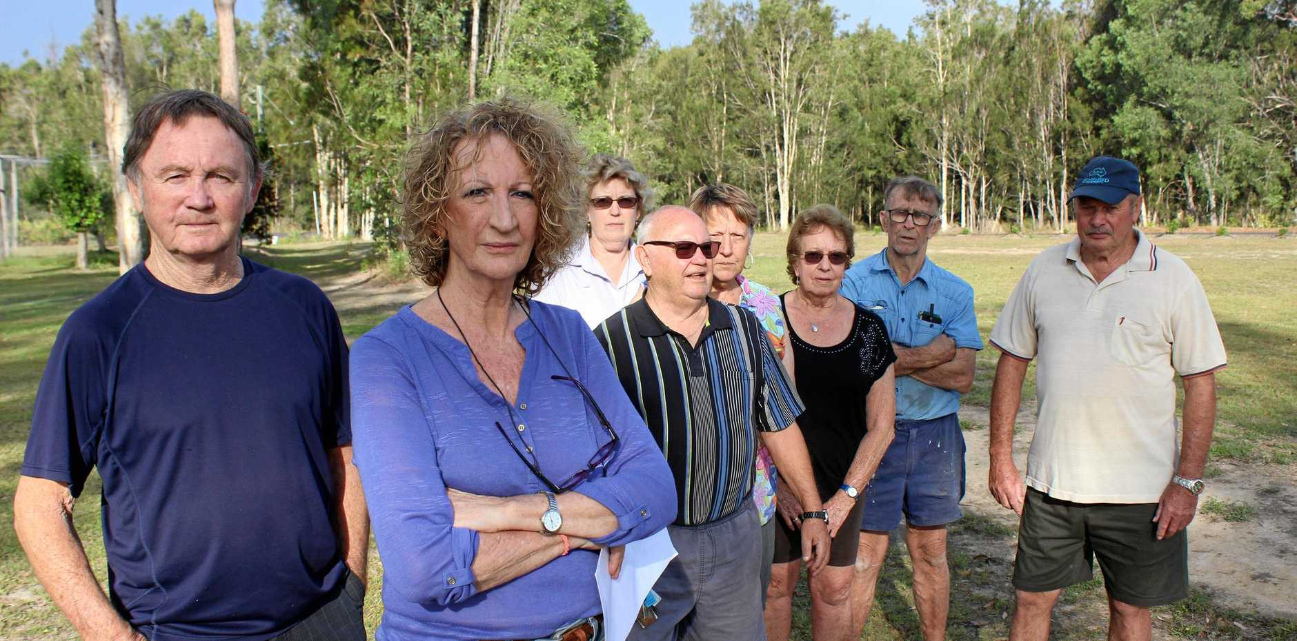 NOT IN MY BACKYARD: Ed and Deb Doble stand with other local residents opposed to the creation of a 255-unit manufactured housing estate.