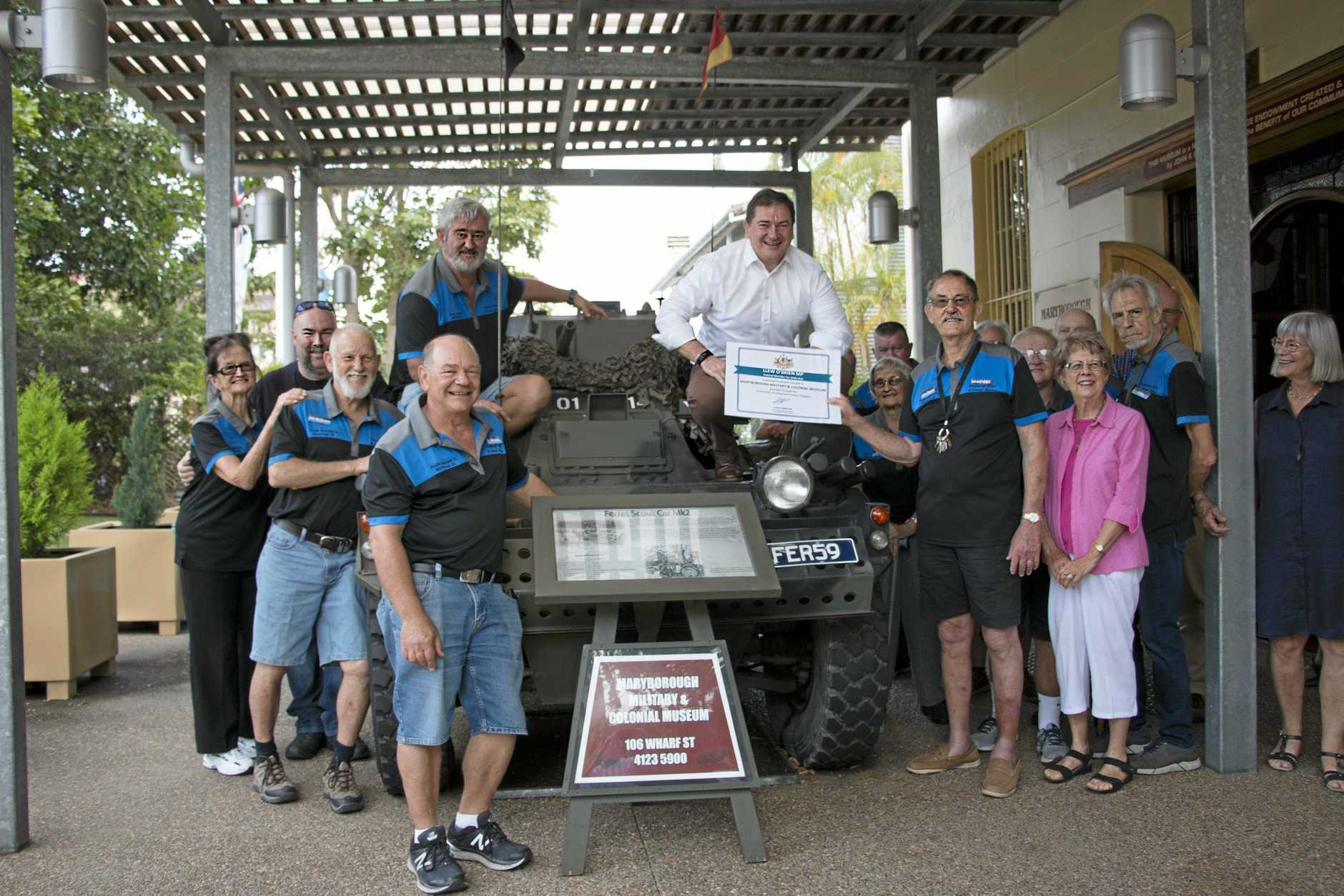 Federal Member for Wide Bay Llew O'Brien met with Maryborough Military and Colonial Museum volunteers to deliver a $50,000 grant for solar panels and air-conditioning to be installed.