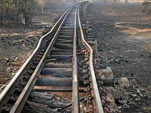 Rail line buckled by intense fire