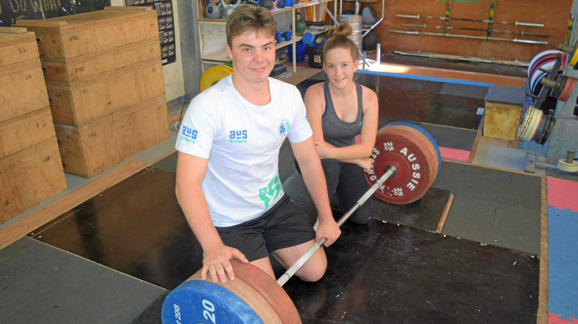 Whitsunday Weightlifting athletes Jasper Hope, 17, and Emily Bennett, 14, are all smiles after their success at the 2019 Australian Under 15 and Youth Championships.
