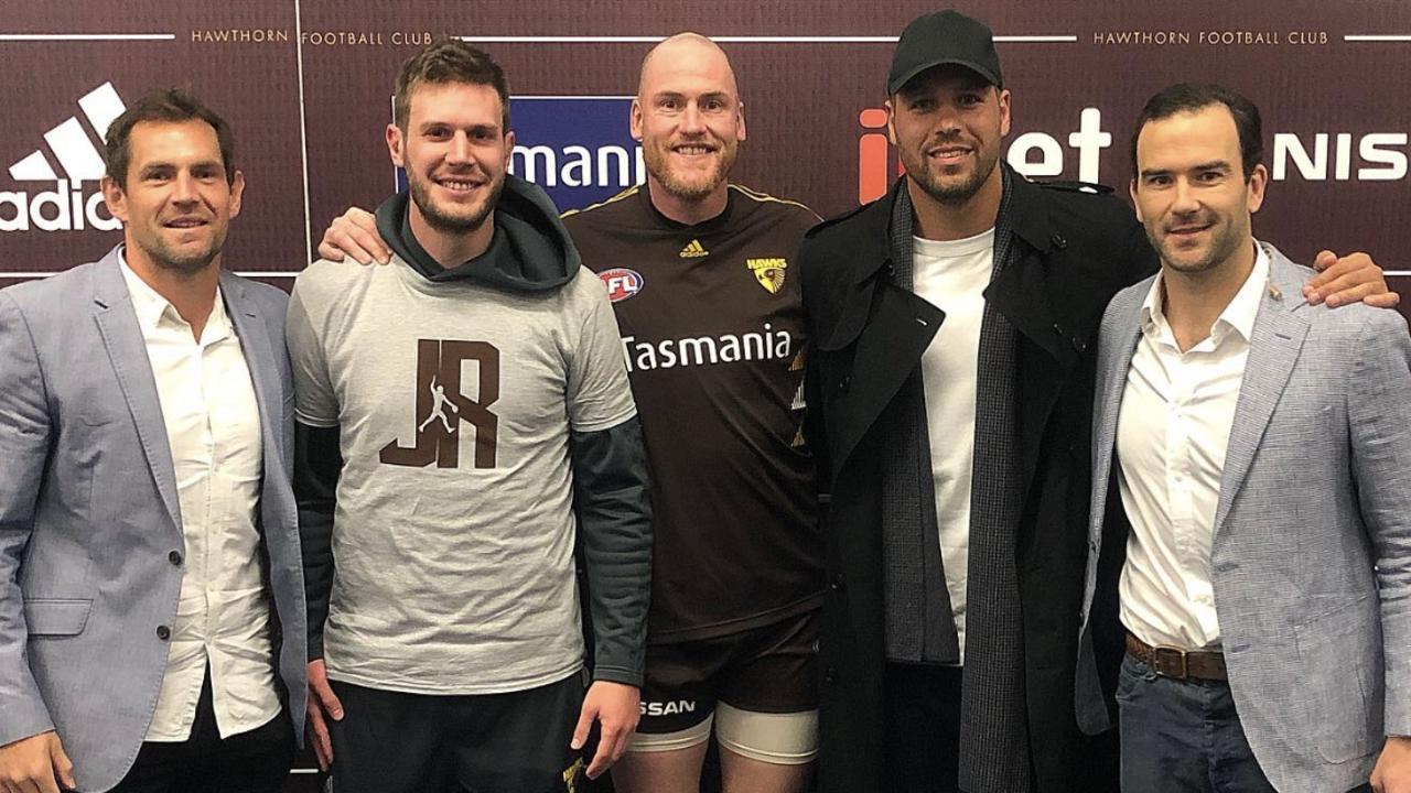 Luke Hodge and Birchall, left, before great mate Jarryd Roughead's final AFL game alongside fellow former Hawk greats Lance Franklin and Jordan Lewis.