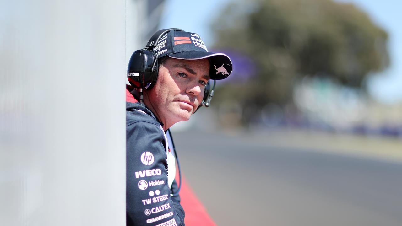 Craig Lowndes takes in practice from pit lane.