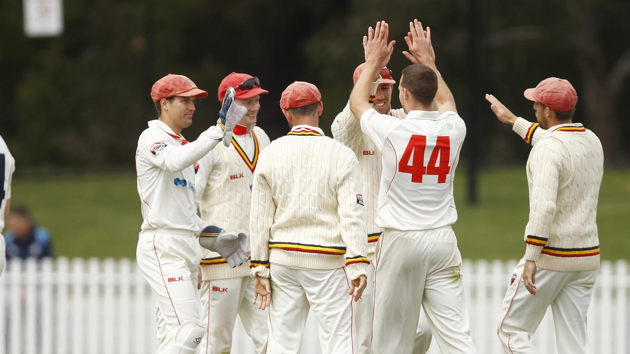 The Redbacks celebrate taking their only wicket of the day against Victoria — that of Marcus Harris for 116. Picture: DANIEL POCKETT (Getty Images).