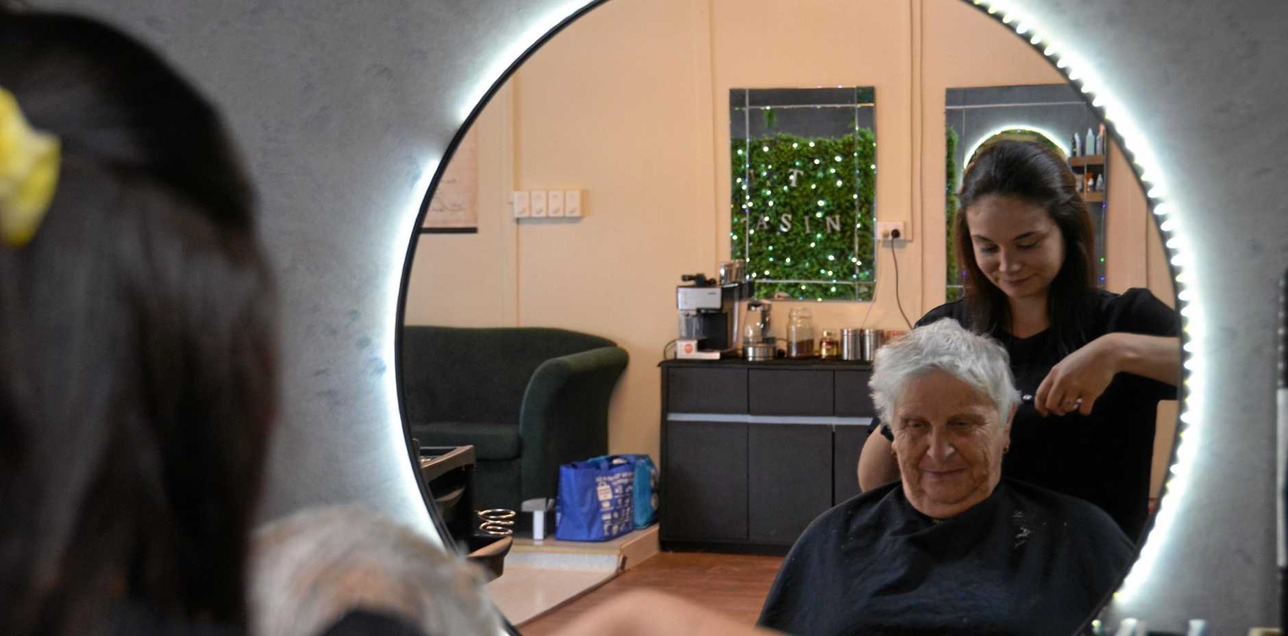 Gloria Curtis getting her hair trimmed by new up and coming stylist Sarah Black at Just Teasin' Hair and Beauty in Monto.