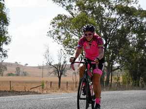 Alone and in stifling heat, a rider pedals the Burnett Hwy