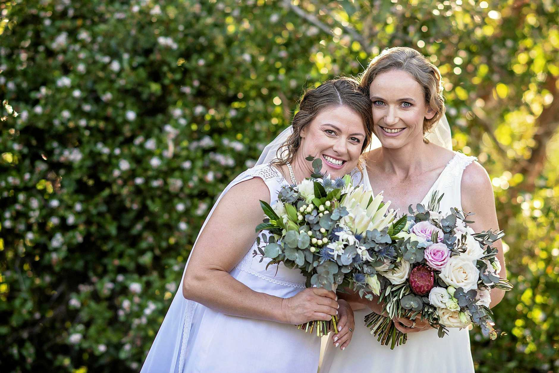 The loved-up couple Jenny Munro and Larisa Seghers on their wedding day.