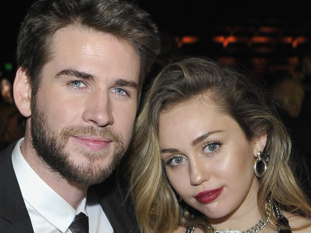 Liam Hemsworth (L) and Miley Cyrus. Picture: Getty