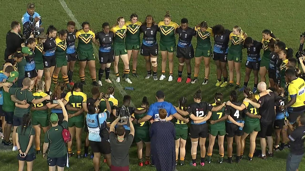 Australia and Fiji players come together after their clash in Suva.