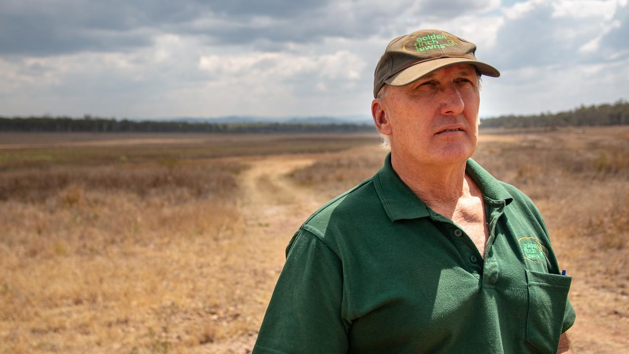 """WORRIED: Coominya turf grower Greg Banff stands in the near-empty Atkinson Dam. Mr Banff warned the new pric path for irrigators would be """"devastating"""". PHOTO: Dominic Elsome"""