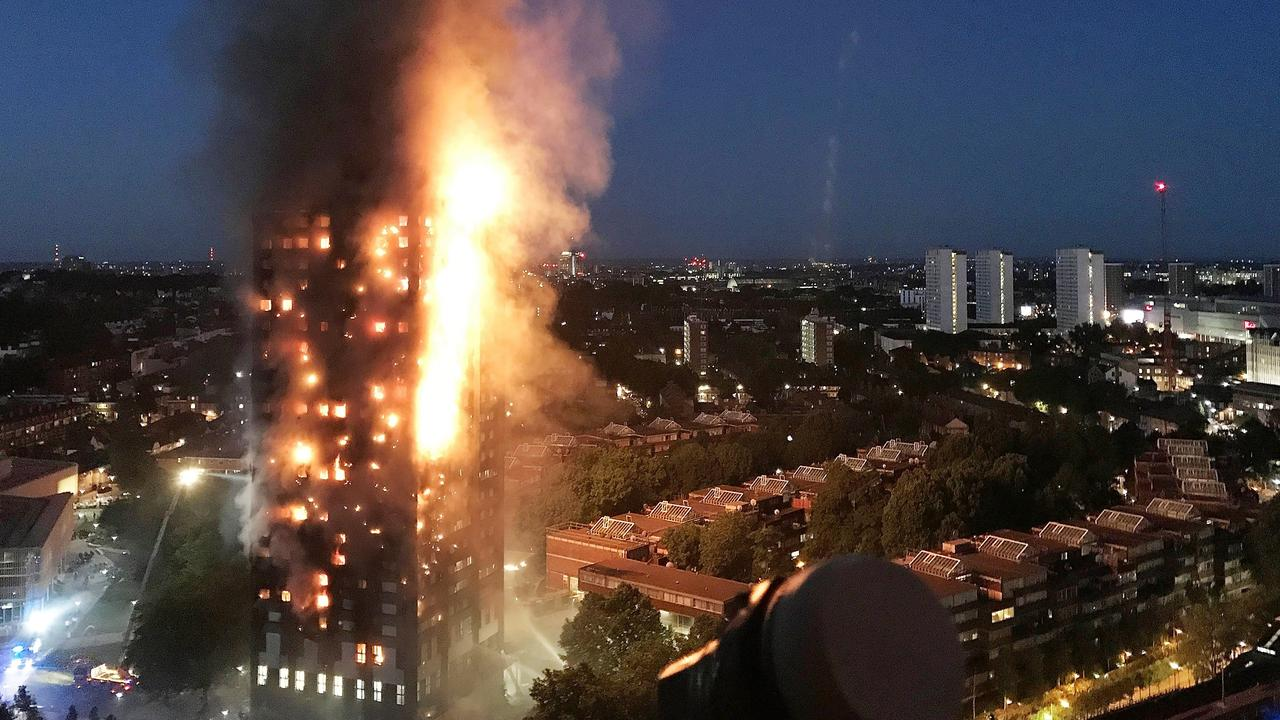 Spreading vertically via combustible cladding, fire engulfs London's Grenfell Tower.