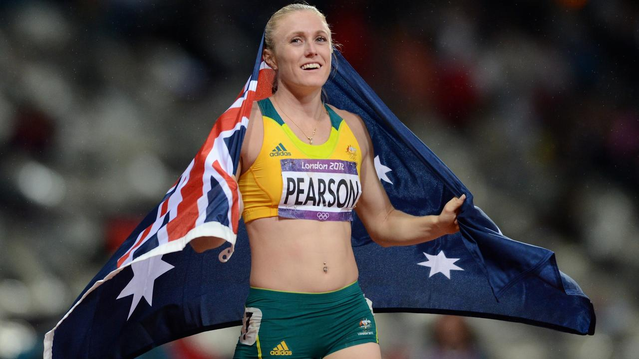 Australia's Sally Pearson celebrates her gold medal win in the women's 100m hurdles at the athletics DURING the Olympic Games in London, 2012. Picture: AAP Image/Dean Lewins
