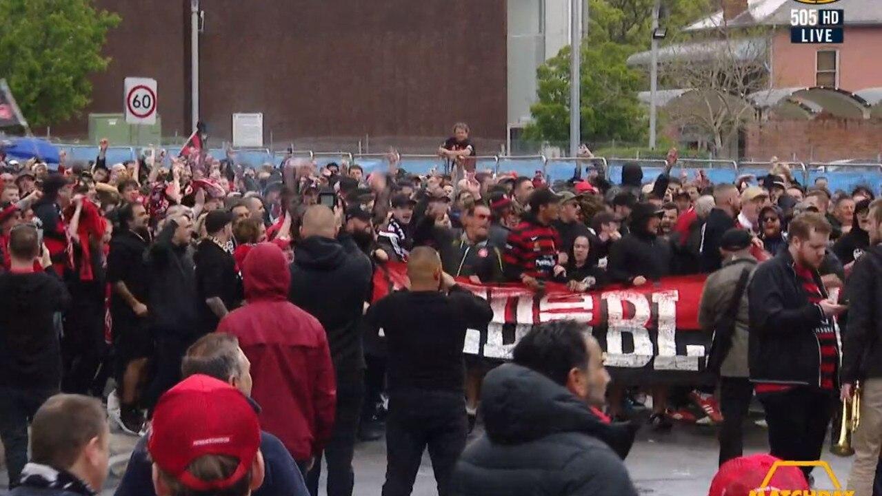 Wanderers fans march through Parramatta to Bankwest Stadium.