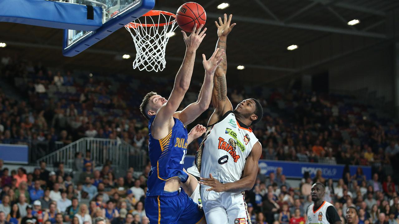 Will Magnay (left) battles with Cameron Oliver of the Taipans