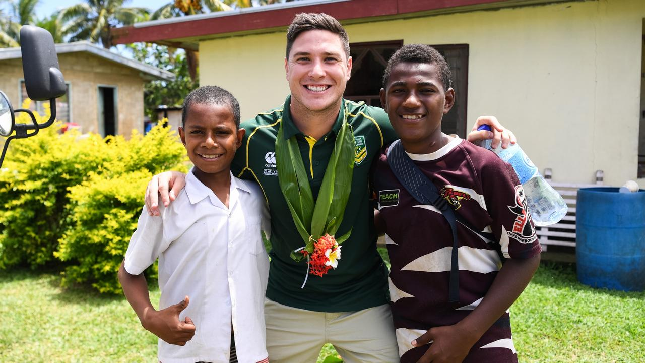Mitchell Moses meets a couple of locals in Fiji. Photo: Nathan Hopkins/NRL Photos