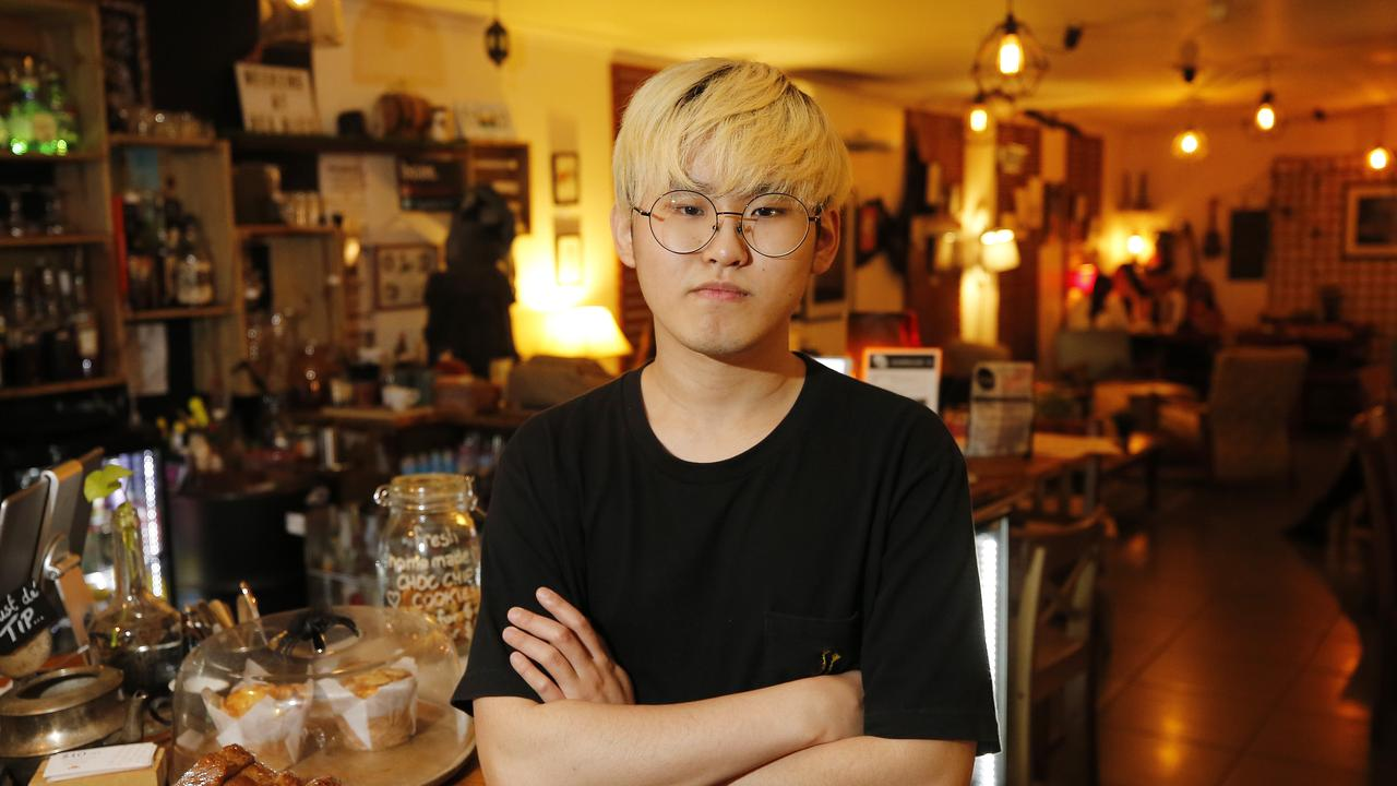 Jun Park from Bean Cafe Bar posing at their business in Brisbane, 10th of October 2019. The Extinction Rebellion protests have effected a number of businesses in the CBD. (AAP Image/Josh Woning)